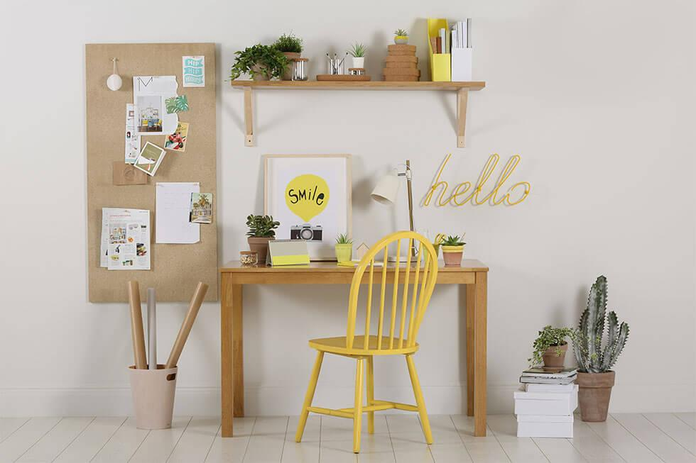 A neutral study space with a yellow chair.