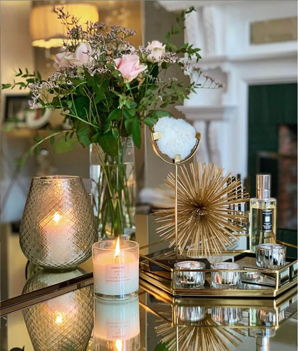 Coffee table in the living room with candles, ornaments and flowers