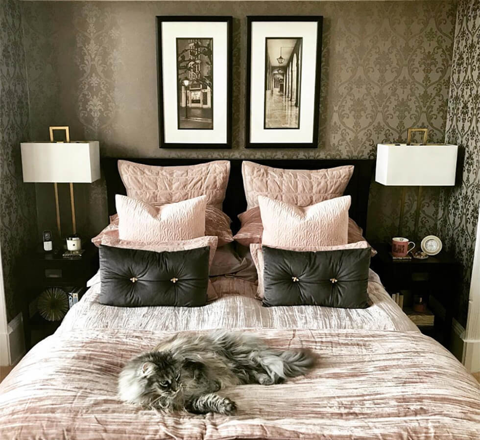Master bedroom with patterned wallpaper and bedding with soft textures