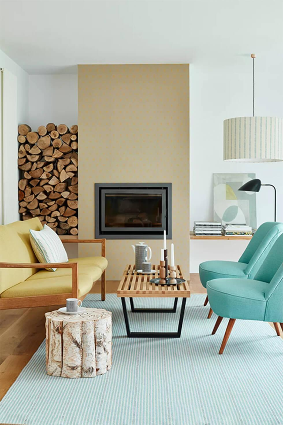 Minimal mid-century living room with yellow sofa and teal armchairs