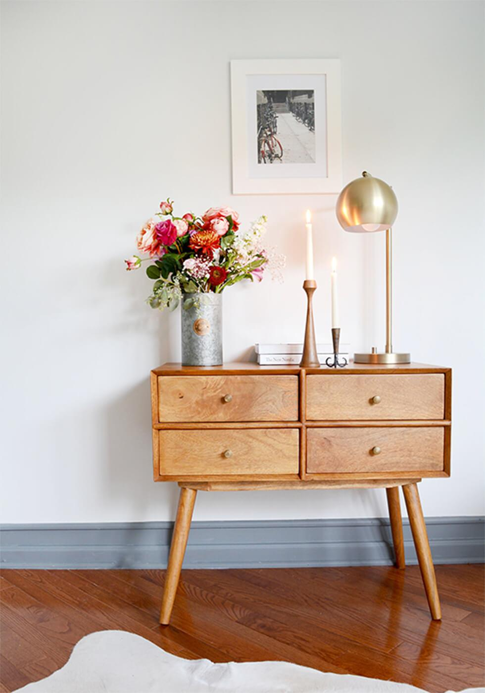 Mid-century chest of drawers with statement domed brass lamp