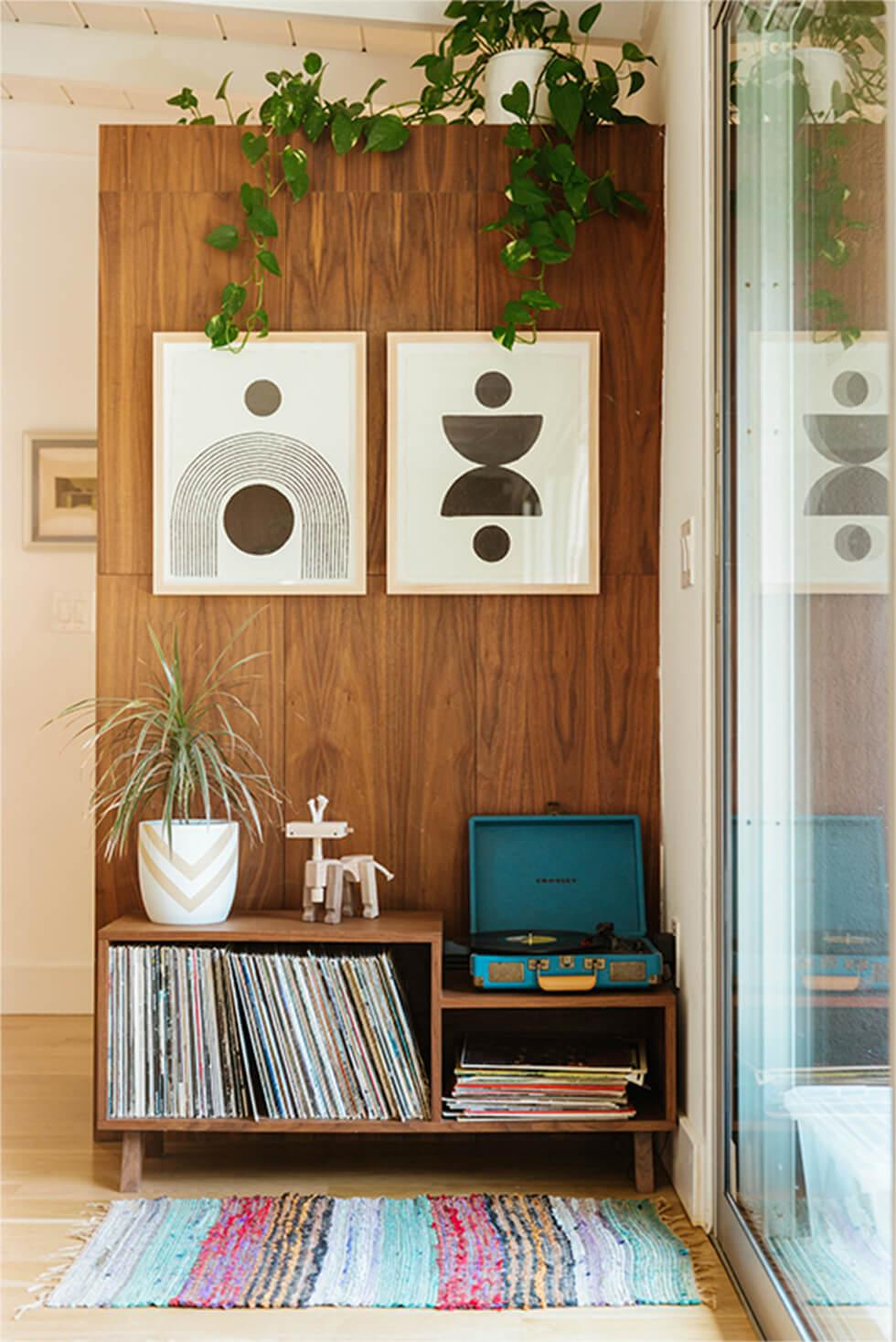 Vintage room with wood panels, mid-century art and indoor plants