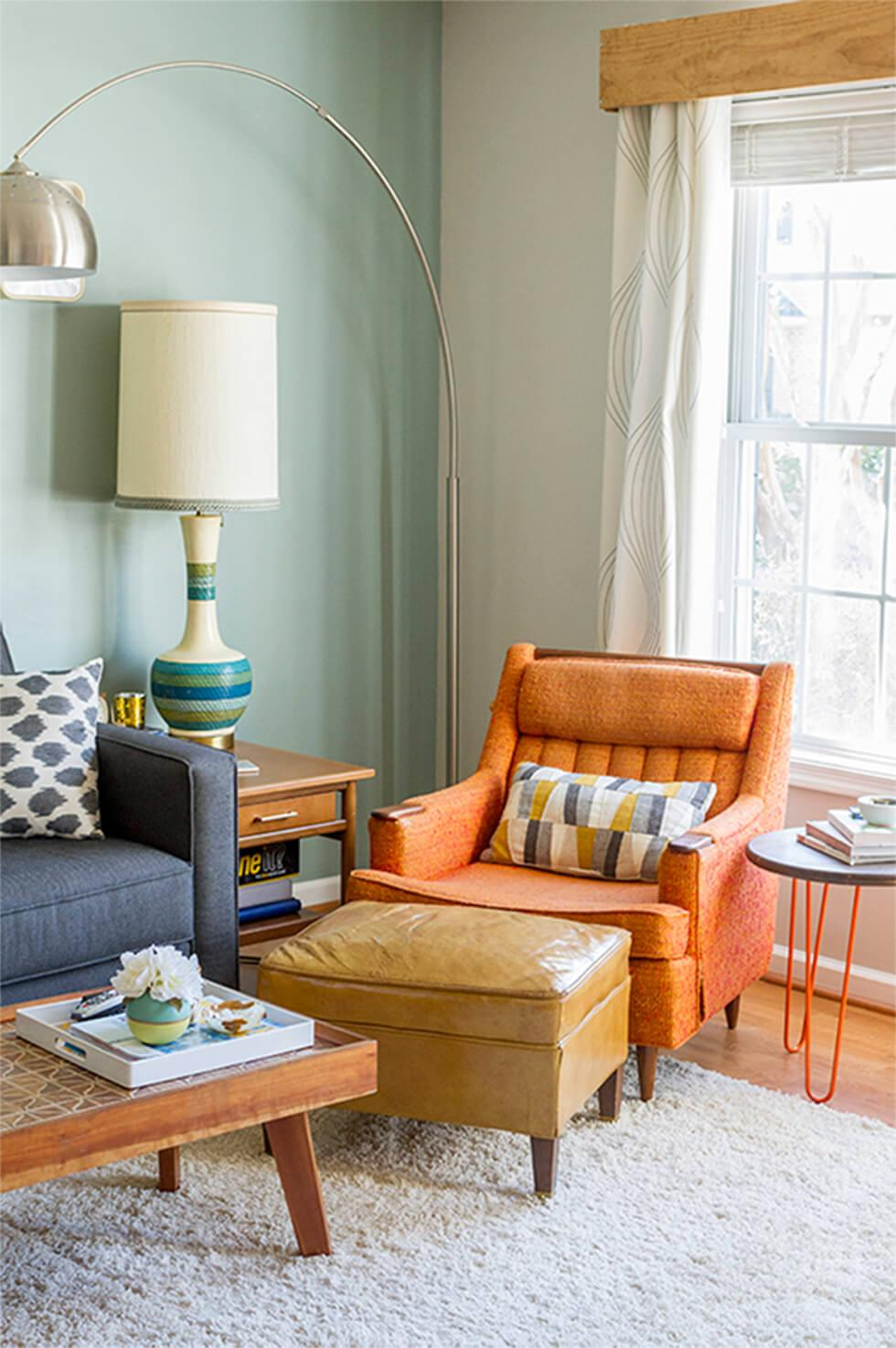 Cosy mid-century living room with orange armchair