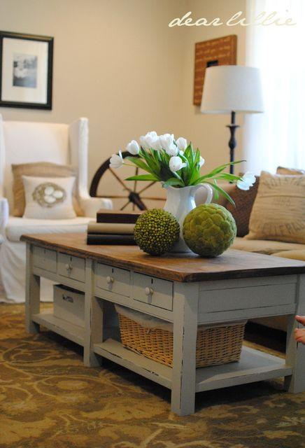 Baskets stored under coffee table.
