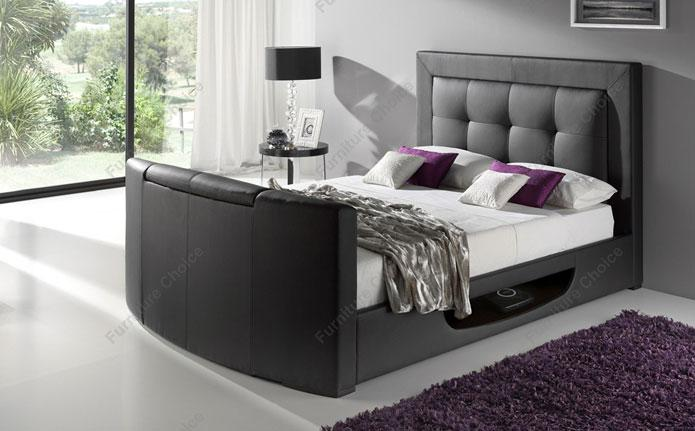 Dark bed frame with white sheets and pillows.