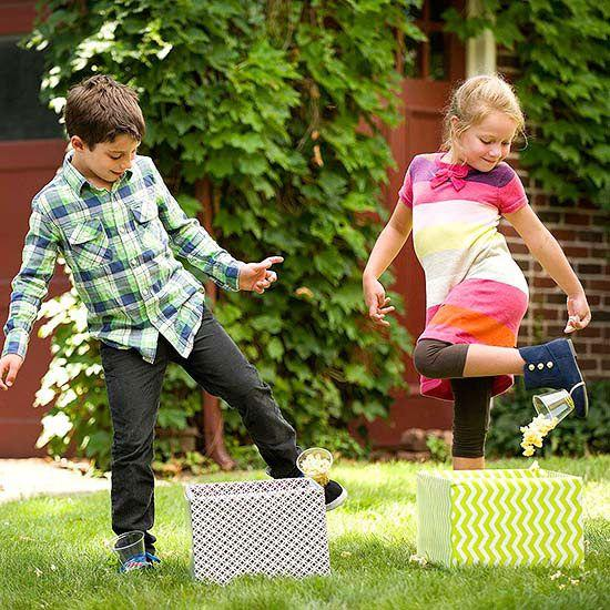 Two children playing with printed boxes.
