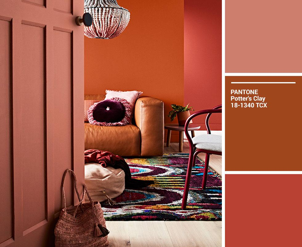 A living room in varying shades of orange, brown and red.