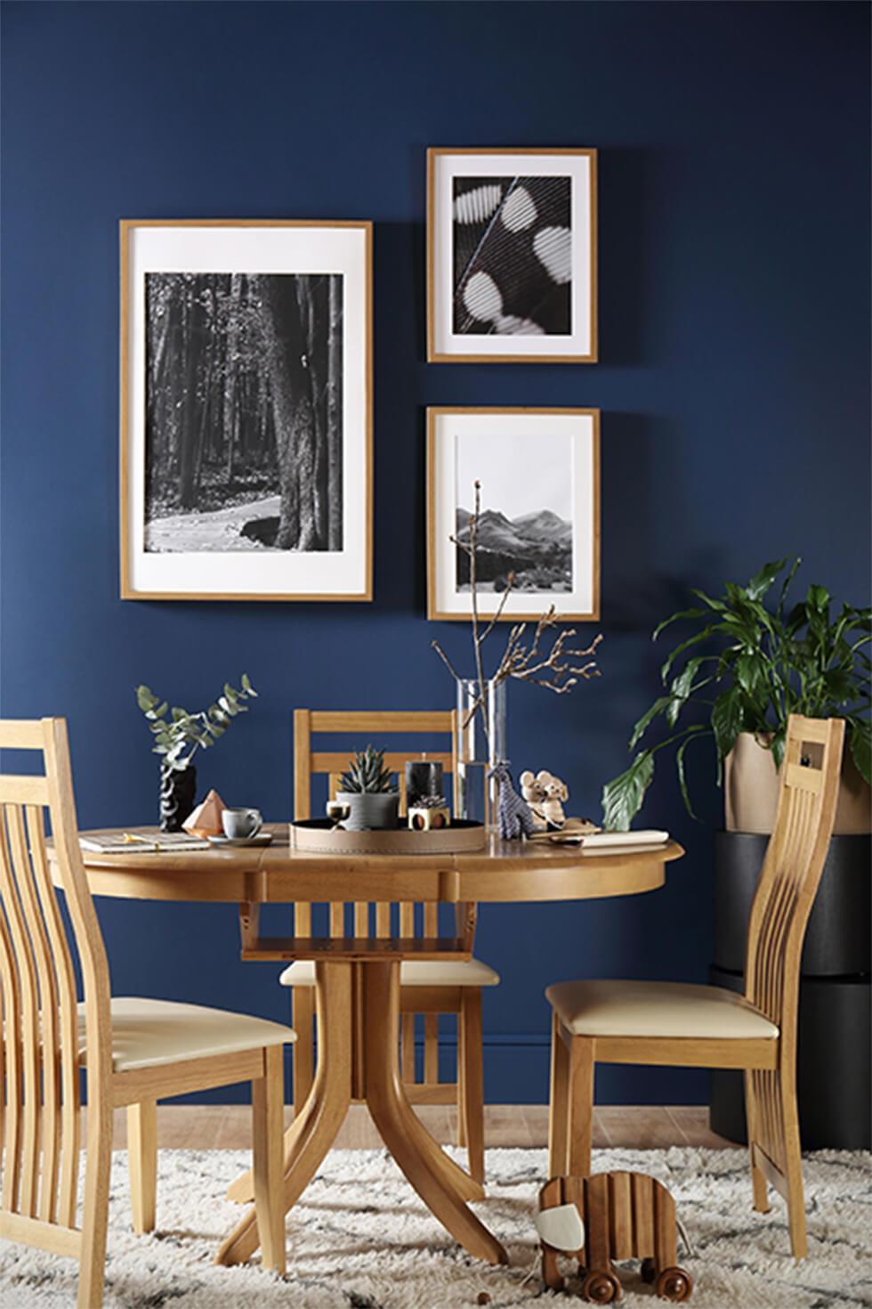 Oak dining set in dark blue dining room