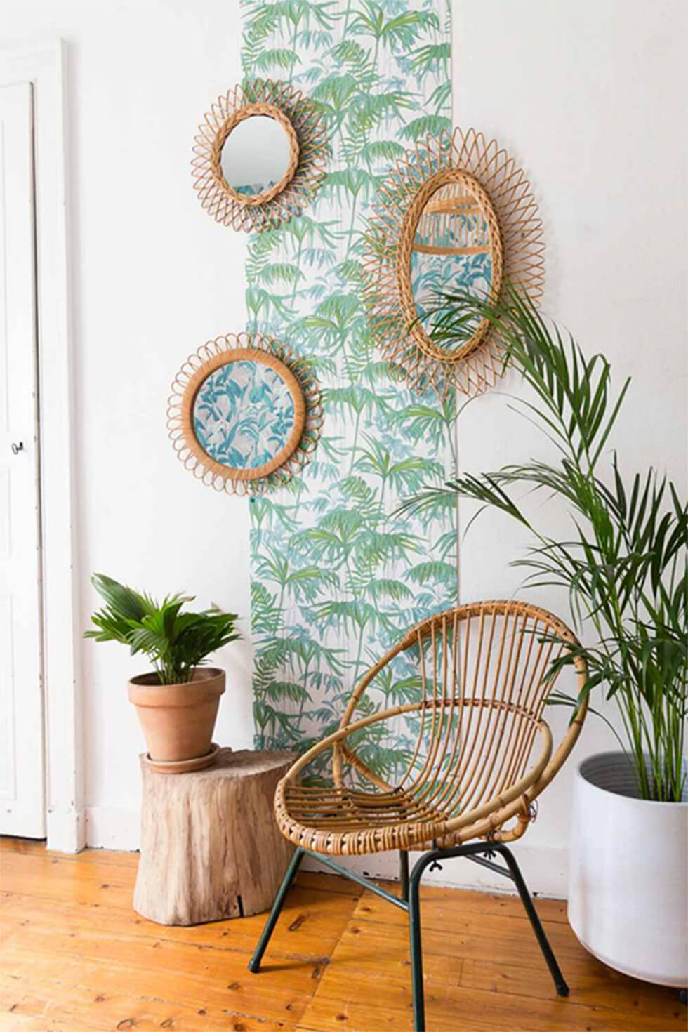 Rattan chair with bohemian wallpaper print
