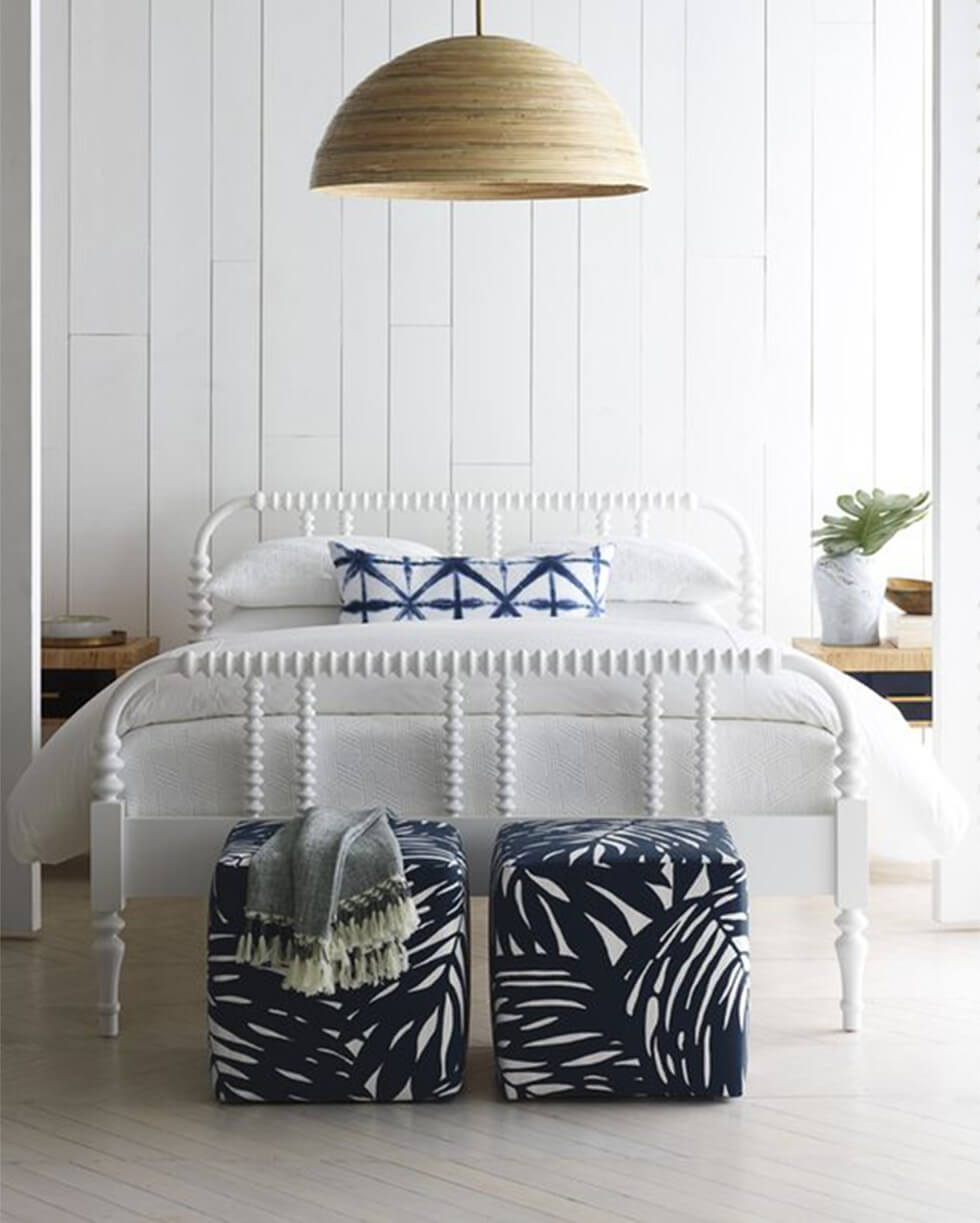 Bedroom with white wall panels and indigo patterns