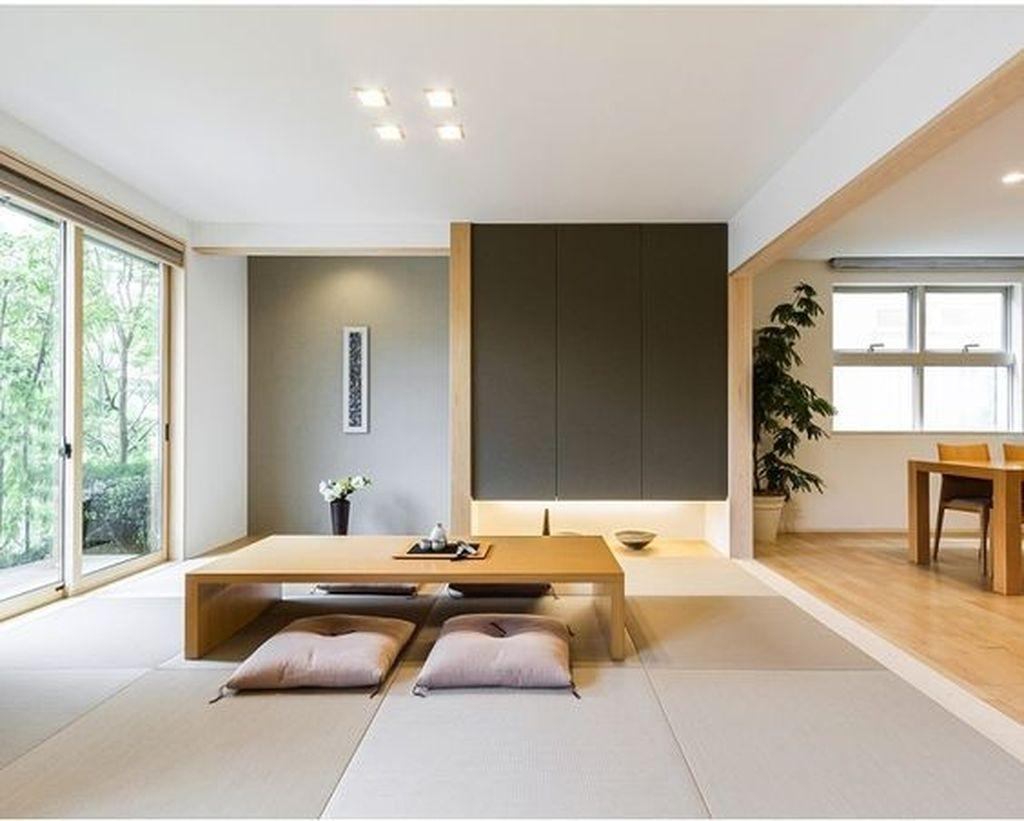 Open plan space with tatami mats and low wooden table.