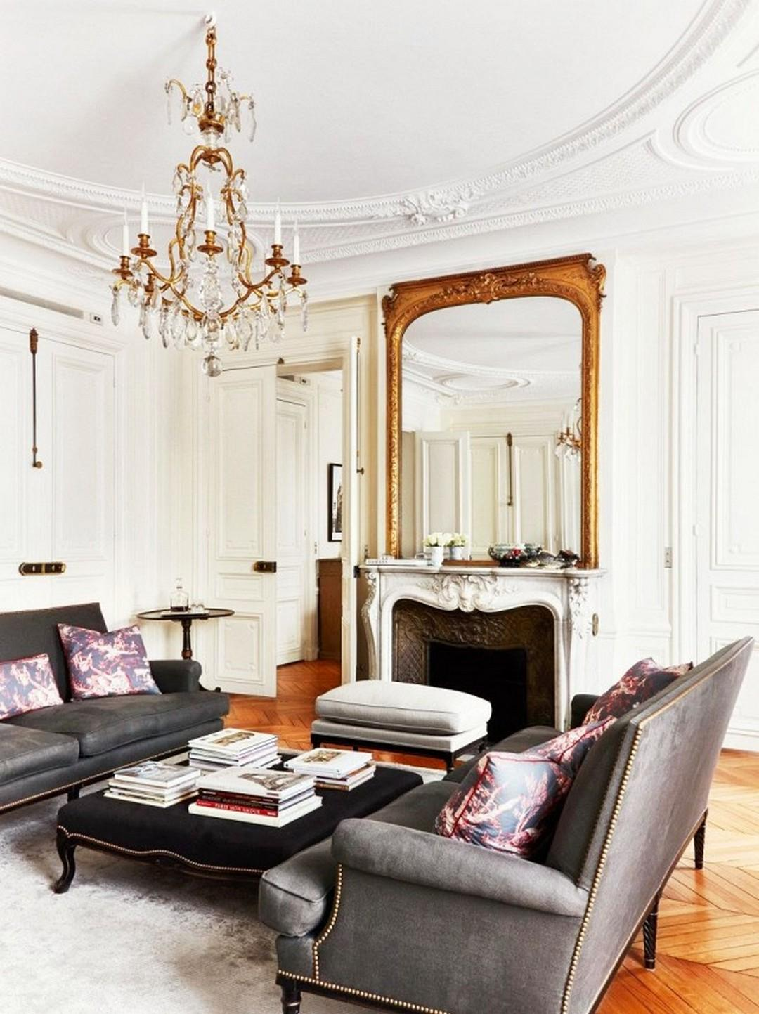 Chic parisian living room with black sofa and crystal chandelier.