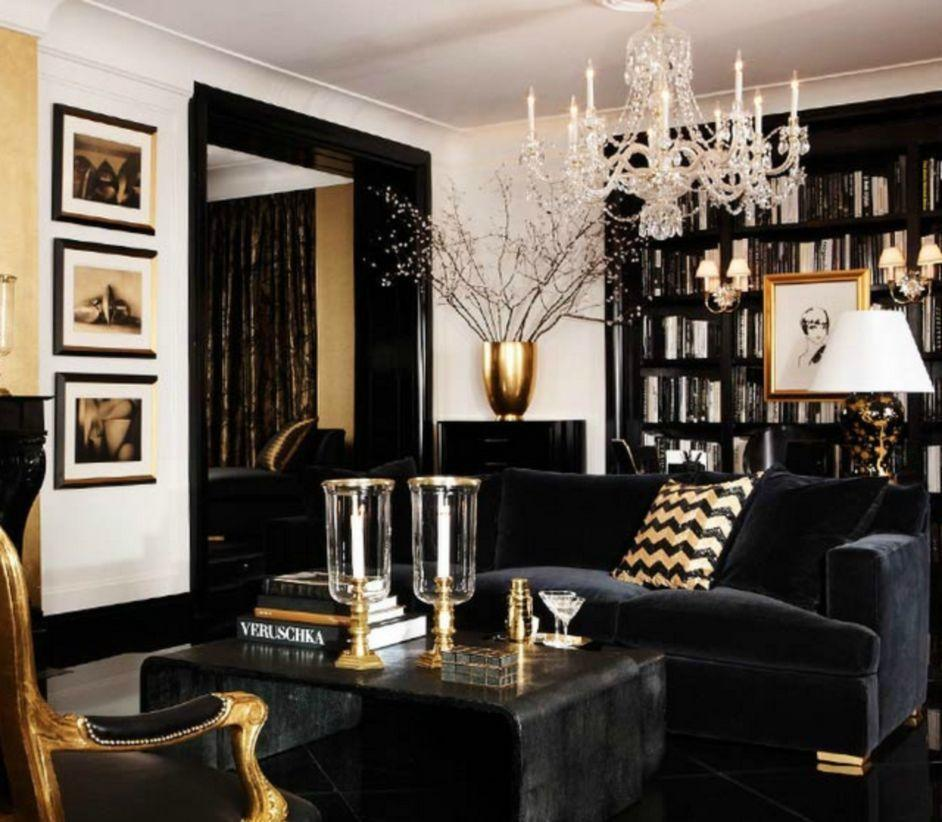 Art Deco style living room with monochrome furniture, gold details and chandelier.