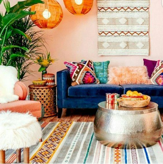Moroccan style living room with colourful patterned rugs and kilim cushions.