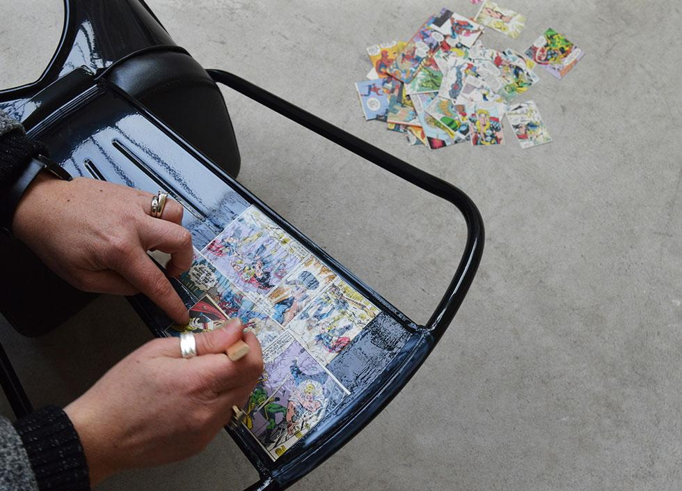 gently stick the comic clippings onto the chair