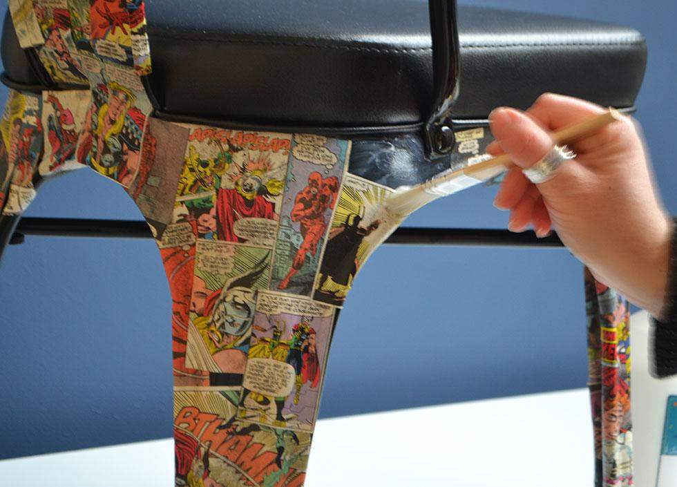 Once all areas are covered with the comics, apply a thin coat of glue over the surface to seal them in