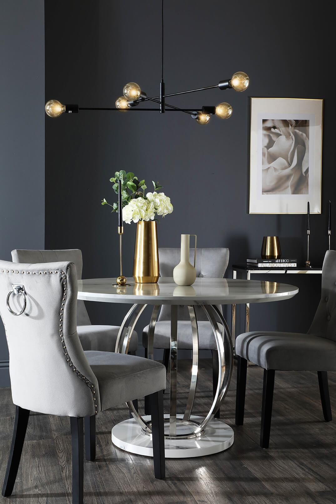 Sleek marble and chrome brightens a dining area.